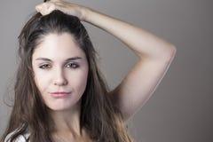 Портрет молодой женщины брюнет делая стороны с различным e Стоковые Фото