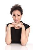 Портрет молодой коммерсантки изолированной в черном платье Стоковая Фотография