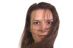 Портрет девушки с ветром в ее волосах Стоковое Фото