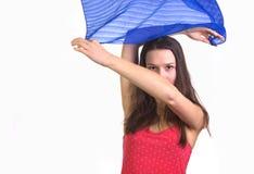 Девушка развевая с голубым половиком Стоковые Фото