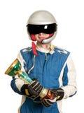 Портрет мужского победителя гонщика с чашкой трофея золота изолированной на белизне стоковое фото