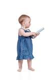 Портрет младенца используя remote управления Стоковые Изображения RF