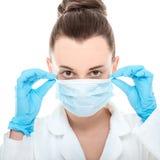 Портрет доктора молодой женщины на белой предпосылке Стоковое Фото