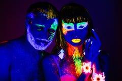 Портрет пары любовников покрашенных в дневном порошке Стоковое Фото