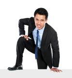 Портрет подъема бизнесмена стена стоковое изображение rf