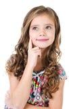Портрет прелестной мечтая изолированной маленькой девочки Стоковые Фото