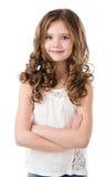 Портрет прелестной усмехаясь изолированной маленькой девочки Стоковое Изображение