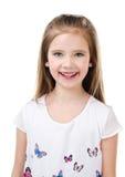 Портрет прелестной усмехаясь изолированной маленькой девочки Стоковое фото RF