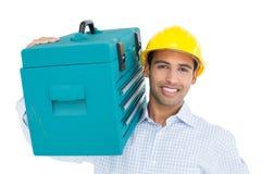 Портрет разнорабочего в трудной шляпе нося toolbox Стоковые Изображения RF