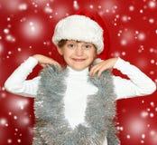 Портрет ребенка девушки на красном цвете, концепции зимнего отдыха Стоковые Изображения RF
