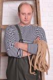 Портрет рыболова в waders с веревочкой Стоковые Изображения