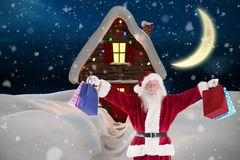 Портрет Санта Клауса держа сумки подарка рождества Стоковое Фото