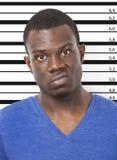 Портрет сердитого молодого Афро-американского человека против диаграммы высоты Стоковые Изображения RF