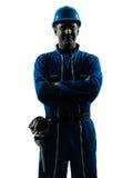 Портрет силуэта рабочий-строителя человека усмехаясь дружелюбный Стоковое фото RF