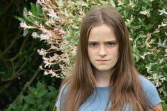 Портрет скептичного смотря девочка-подростка стоковое фото rf