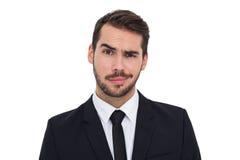 Портрет скептичного хорошо одетого бизнесмена Стоковые Фотографии RF