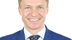 Портрет смеясь над бизнесмена, усмехающся, белая предпосылка стоковые фото