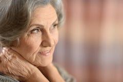 Портрет средн-постаретой женщины Стоковая Фотография