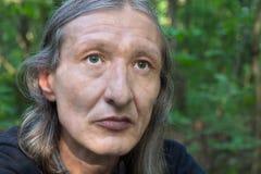 Портрет средн-постаретые люди с длинными волосами Стоковое фото RF