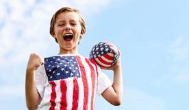 Портрет счастливого маленького игрока рэгби с шариком Стоковые Фото