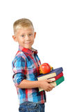 Портрет счастливого школьника с книгами и яблока изолированного на белой предпосылке Образование Стоковая Фотография RF