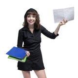 Портрет счастливой бизнес-леди держа бумаги Стоковая Фотография
