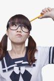 Портрет думать девушки школы Стоковое Изображение