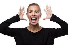 Портрет усиленной женщины на белой предпосылке Стоковое Изображение