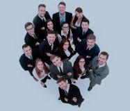 Портрет усмехаясь бизнесменов против белой предпосылки Стоковое Изображение