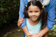 Портрет усмехаясь девушки с бабушкой Стоковое Изображение