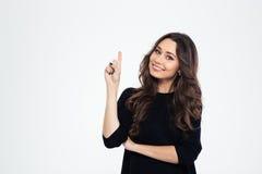 Портрет усмехаясь девушки указывая палец вверх Стоковое фото RF