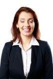 Портрет усмехаясь коммерсантки с закрытыми глазами стоковое фото