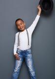 Портрет усмехаясь мальчика при поднятая рука Стоковое фото RF