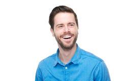 Портрет усмехаясь молодого человека с голубой рубашкой Стоковое фото RF