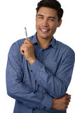 Портрет усмехаясь ручки удерживания бизнесмена Стоковая Фотография RF