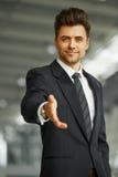 Портрет успешного бизнесмена давая руку Стоковая Фотография RF