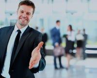 Портрет успешного бизнесмена давая руку Стоковые Изображения RF