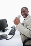 Портрет успешного бизнесмена используя компьютер Стоковые Изображения