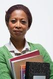Портрет учителя держа книги стоковая фотография