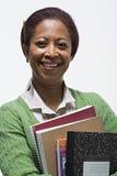 Портрет учителя держа книги стоковое изображение rf