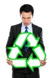 Портрет удерживания бизнесмена рециркулирует знак стоковые изображения rf
