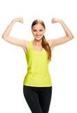 Портрет фитнеса женщины показывать бицепс Стоковая Фотография
