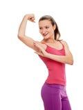 Портрет фитнеса женщины усмехаясь показывать бицепс Стоковые Фотографии RF