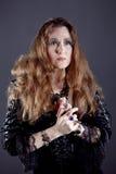 Молодые женщины в черном длиннем платье Стоковое фото RF