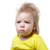Портрет хмурясь изолированный младенец Стоковые Изображения RF