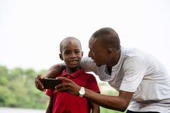 Портрет человека и его ребенка, счастливый стоковое изображение rf