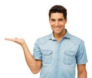Портрет человека показывая незримый продукт стоковое фото rf