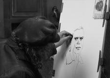 Портрет человека чертежа художника Стоковая Фотография