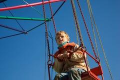 портрет carousel мальчика усадил Стоковые Изображения RF