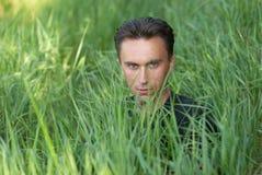 портрет s человека травы Стоковое Изображение